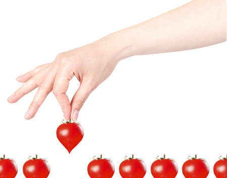 chose: Stylish red valentine day heart background with hand and sherry tomatoes isolated