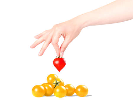 the chosen one: Stylish red valentine day heart background with hand and sherry tomatoes isolated