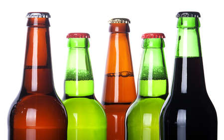 Frosty bottles of beer isolated on a white background photo