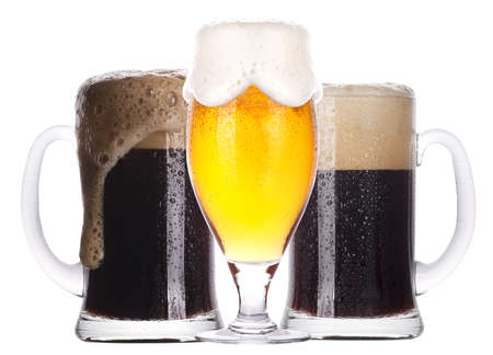 Frosty glass of light and dark beer set isolated on a white background photo