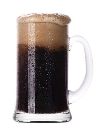 Frosty glass of dark beer isolated on a white background photo