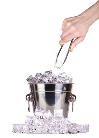 ice bucket with hand holding Ice tongs isolated Stock Photo - 17775084