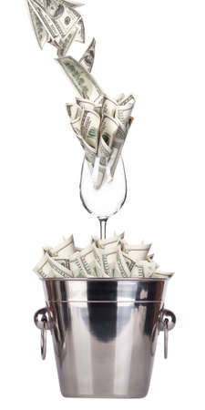 bucket of money: Bucket with money and wineglass  on white background Isolated Stock Photo
