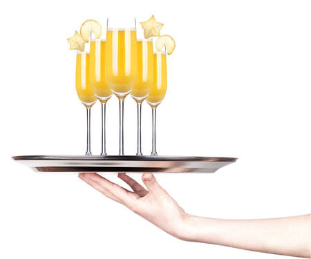 hand with alcohol cocktail on a silver tray isolated on a white background photo