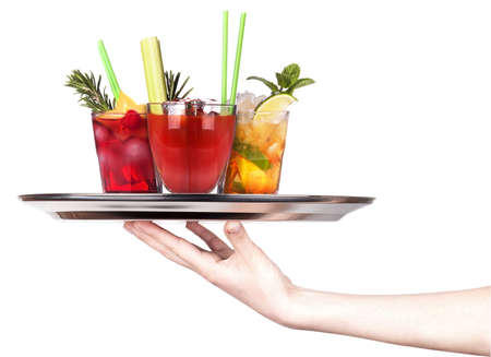 cocktail drinks: hand with alcohol cocktail on a silver tray isolated on a white background Stock Photo