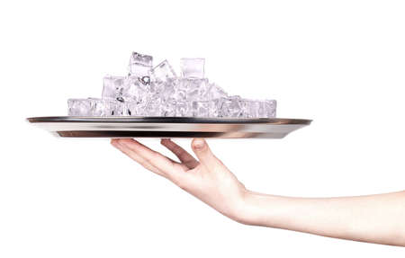 silver tray full of ice with hand isolated photo