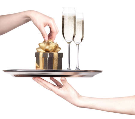s eve: tray with champagne and gift box isolated