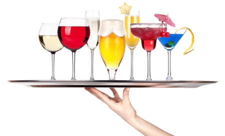 different alcohol drinks on a tray isolated on a white background photo
