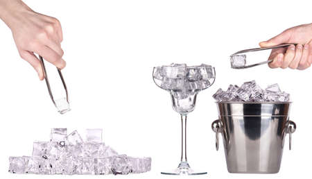 bar accessories with ice and full of ice cocktail glass with hand isolated