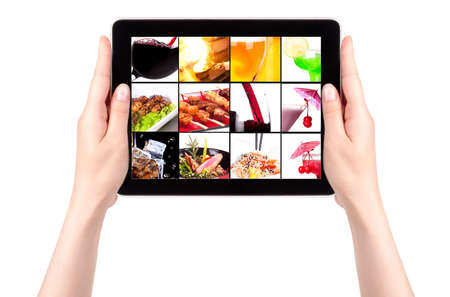 different meat dishes and alcohol drinks on a digital tablet screen photo