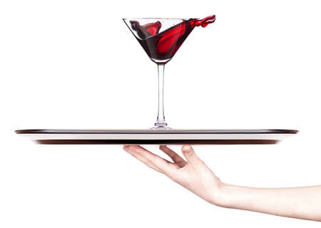 Red cocktail with splash on a tray with hand isolated on white photo