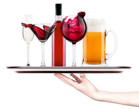 alcoholic cocktail set  on a silver tray with hand - cocktail, cola, beer, wine,champagne photo