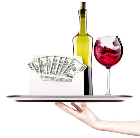 money in envelope isolated on a tray with red wine and woman hand photo