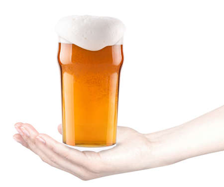 frosty fresh glass of beer with woman hand isolated photo