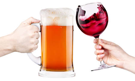 beer and wine: celebrate the holiday background - hands with wine and beer making toast