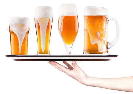 Frosty fresh beer with foam on a silver tray with waitress hand isolated photo