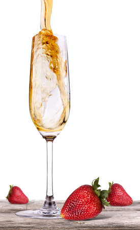 champagne on a vintage wooden table with fresh red strawberry photo