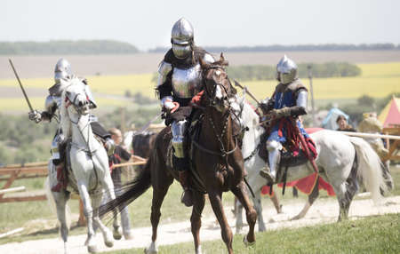 showmanship: Medieval knights in battle background Stock Photo