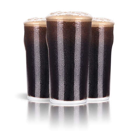 Frosty glass of dark beer set isolated on a white background photo