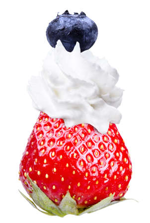 whipped cream: Whipped cream with tasty blue berrie and strawberry on a top isolated background