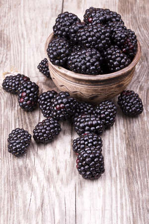 blackberries on wooden table with water drops background Stock Photo - 20004304