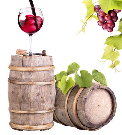 grapes with wine glass and wooden vintage barrel isolated on a white background photo