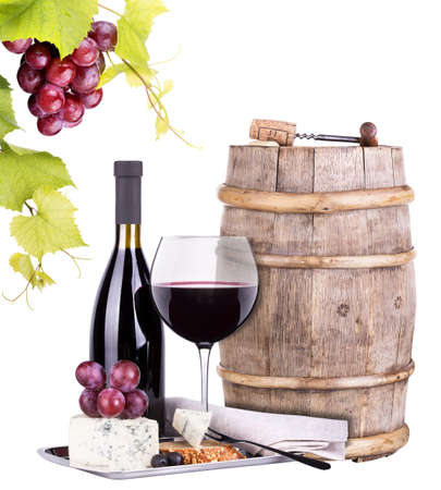 vintage bottle: grapes on a barrel with corkscrew, wine glass and cheese  isolated on a white background Stock Photo