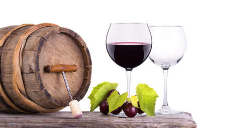Red wine, glass barrel with grapes over white