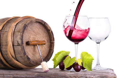 Red wine, glass barrel with grapes over white photo