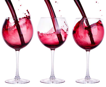 full and empty red wine glass against a white background photo