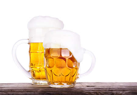 Beer glass on old wooden table background isolated photo