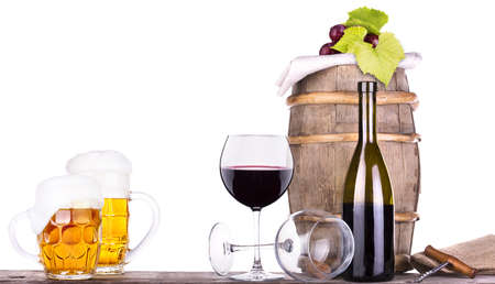 grapes on a wooden vintage barrel with corkscrew and beer glass isolated on a white background Stock Photo - 20450102