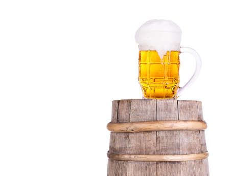 Beer glass on old  wooden vintage barrel  isolated background Stock Photo - 20480272