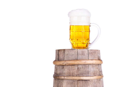Beer glass on old  wooden vintage barrel  isolated background Stock Photo - 20480270