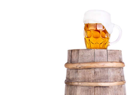 Beer glass on old  wooden vintage barrel  isolated background Stock Photo - 20480285