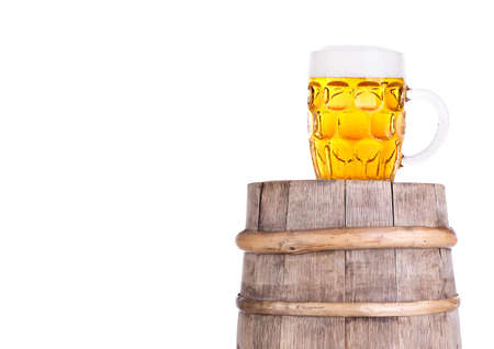 Beer glass on old  wooden vintage barrel  isolated background Stock Photo - 20480269