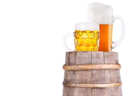 Beer glass on old  wooden vintage barrel  isolated background Stock Photo - 20480281
