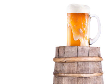 Beer glass on old  wooden vintage barrel  isolated background Stock Photo - 20480293