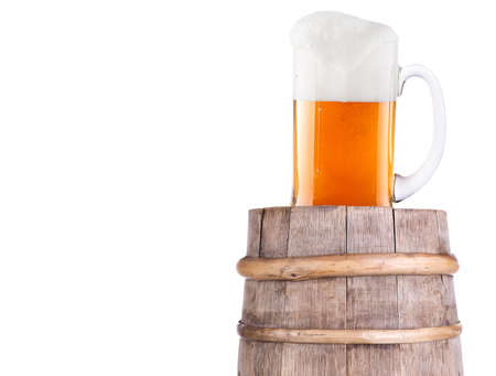 Beer glass on old  wooden vintage barrel  isolated background photo