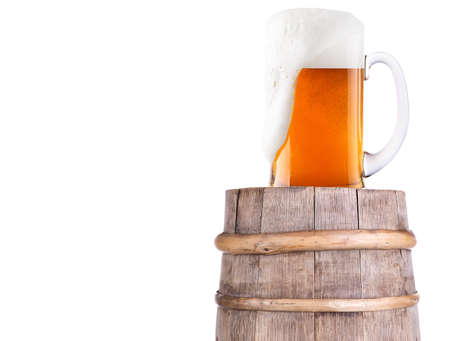 Beer glass on old  wooden vintage barrel  isolated background Stock Photo - 20480280