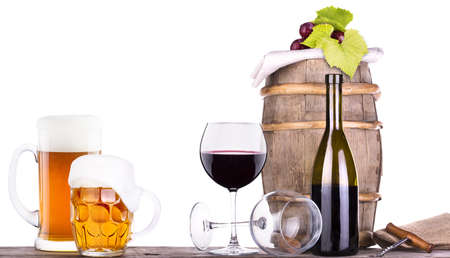 grapes on a wooden vintage barrel with corkscrew and beer glass isolated on a white background Stock Photo - 20480352