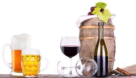 grapes on a wooden vintage barrel with corkscrew and beer glass isolated on a white background Stock Photo - 20480305