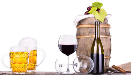 grapes on a wooden vintage barrel with corkscrew and beer glass isolated on a white background Stock Photo - 20480304