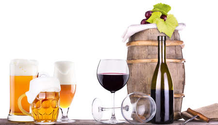 grapes on a wooden vintage barrel with corkscrew and beer glass isolated on a white background Stock Photo - 20480340
