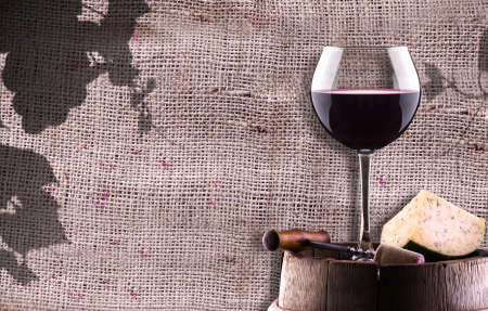 chease, corkscrew and wine glass on a wooden vintage barrel against grunge background
