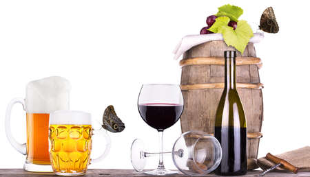 grapes on a wooden vintage barrel with corkscrew, beer glass and butterfly isolated on a white background Stock Photo - 20734123
