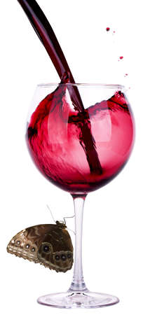 Splash red wine against a white and butterfly background photo
