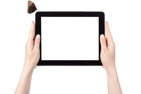 retina display: Hands of a woman holding digital tablet with butterfly  displaying a white screen.