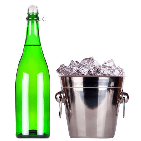 bottle of champagne and Metal ice bucket isolated on a white baclground photo