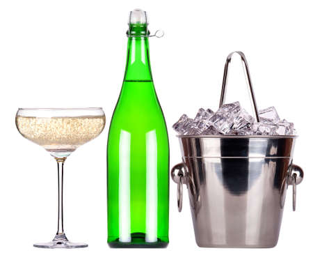 bottle of champagne and Metal ice bucket with glass isolated on a white baclground photo